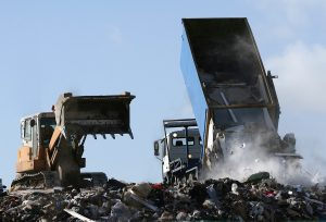 Bulldozer and garbage truck on a landfill site